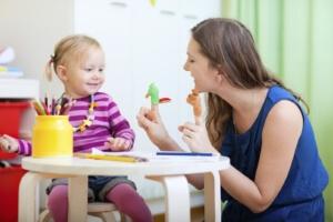 woman works through speech language pathology SLP externship